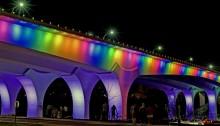 Interestate 35W Bridge in Minneapolis lit up in rainbow colors on June 12, 2016. Photo by MNDOT.